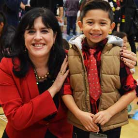 Superintendent Gabriela Mafi and a student