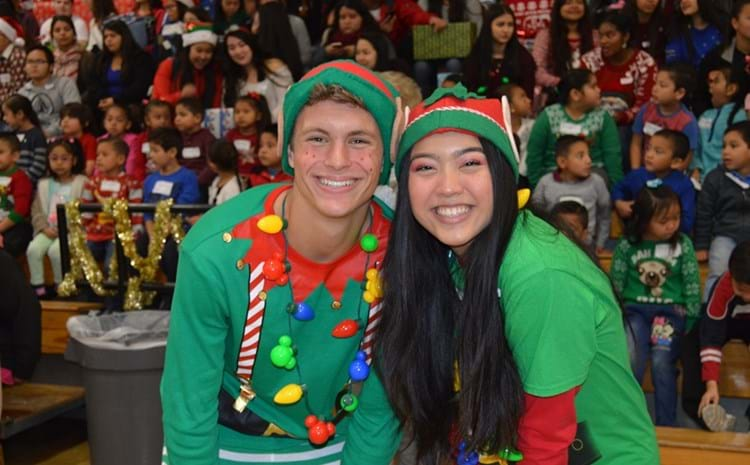 Two Pacifica students dressed as elves.