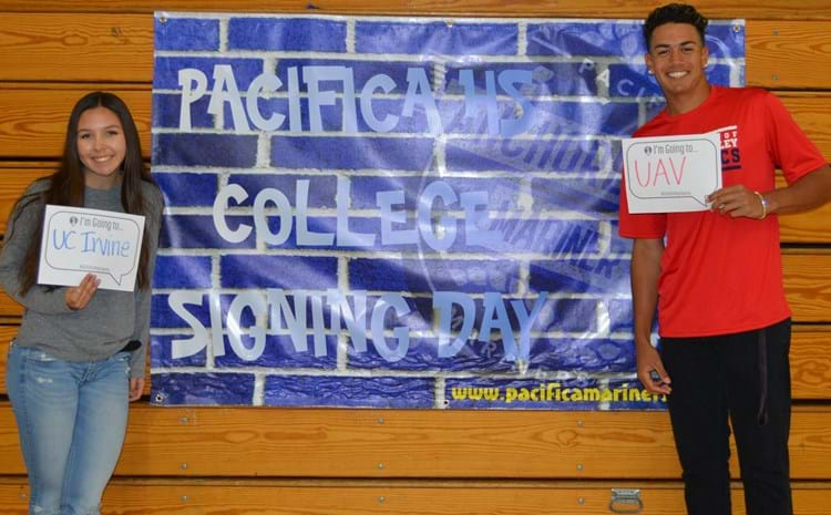 Two Pacifica students displaying the college they are committing to.