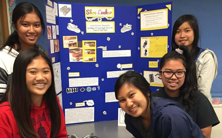 5 female students displaying their creation of a shoe compartment.