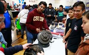 Students take a closer look at automotive parts as part of an interactive display during the 2018 GGUSD Career Fair.