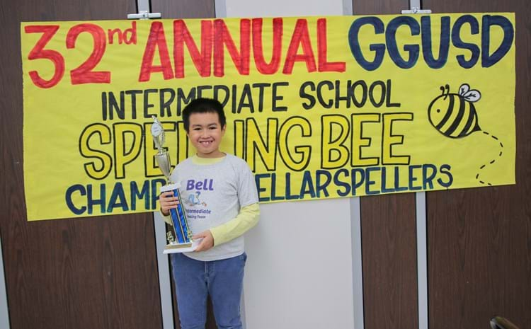 GGUSD 7th-8th grade spelling bee winner, Brandon Tran of Bell Intermediate School, poses with his first place trophy.